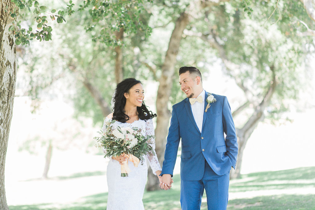 A rustic themed wedding at the Wedgewood Sierra La Verne Country Club by Southern California Natural light Wedding Photographer Madison Ellis Photography .