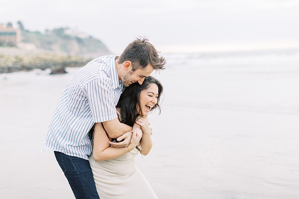 Fun and gloomy engagement session at RAT Beach by Madison Ellis Photography (21)